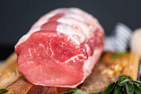 Uncooked boneless pork roast on the cutting board.