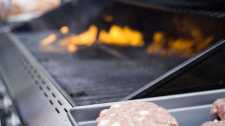 Cooking hamburger beef patties on a gas grill. 写真素材