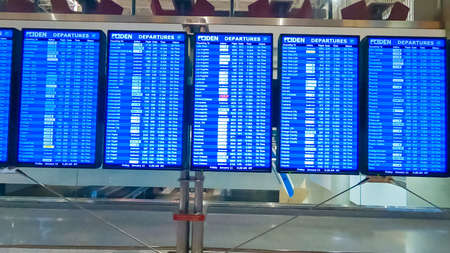 Denver, Colorado, USA-January 11, 2019 - Arrivals and departures board with blue screen inside international airport. Éditoriale