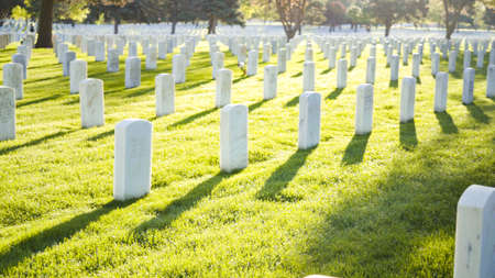 Denver, Colorado, USA-May 26, 2019 - An endless rows of white marble gravestones at the Fort Logan National Cemetery on Memorial Day.