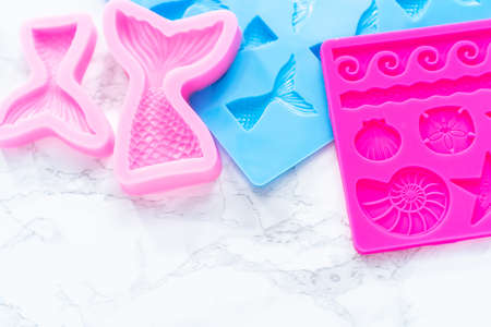 Mermaid theme silicone molds with sea stars and memaid tails.
