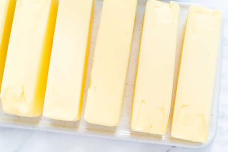 Sticks of butter at room temperature for baking.