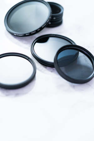 Polarized and neutral density filters on a white table.