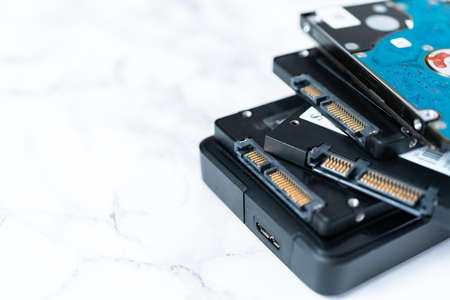 Internal and external solid state hard drives on the table. Stock fotó