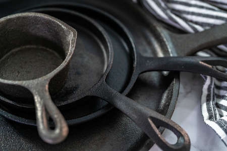 Close up view. Variety of cast iron frying pans on a marble background. 写真素材