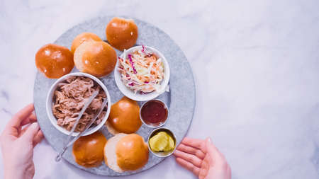 Flat lay. Step by step. Metal serving tray with ingredients to make pulled pork sandwiches.