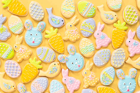 Flat lay. Easter sugar cookies decorated with royal icing of different colors.