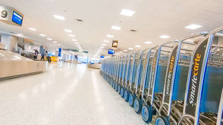 Houston, Texas, USA-January 11, 2019 - Row of airport luggage carts at Houston International Airport.