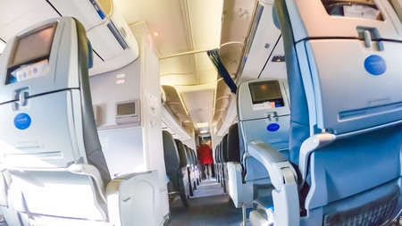 Economy class seats in mid size passenger airplane.