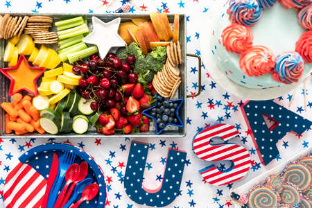 Flat lay. Snack tray with fresh fruits, vegetables, and dips at the July 4th celebration party.
