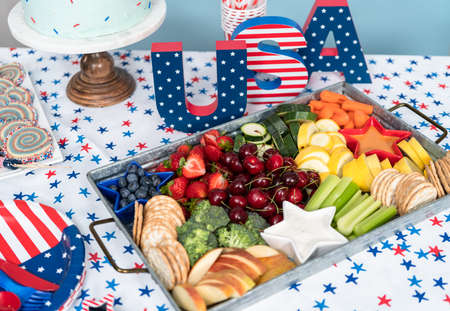 Snack tray with fresh fruits, vegetables, and dips at the July 4th celebration party.