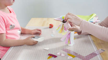 Step by step. Making unicorns out of paper and empty toilet paper rolls.