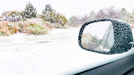 Driving in typical North American suburbs during the first snowstorm of the season.