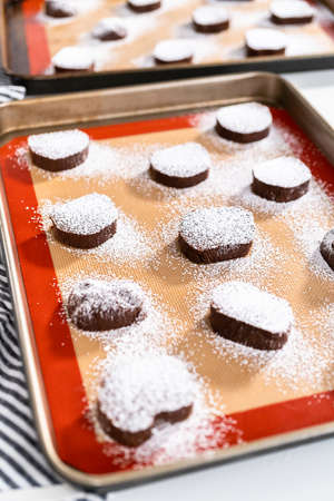 Unbaked chocolate cookies on a baking sheet.