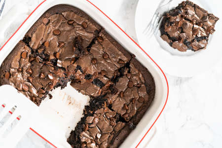 Flat lay. Baking homemade brownies with extra chocolate chips on top. Archivio Fotografico