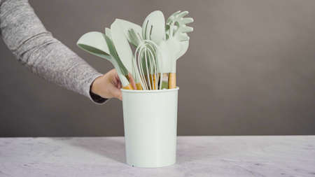 Silicone cooking utensils with wooden handle.