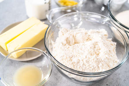 Ingredients in a glass mixing bowls to bake a lemon pound cake. Archivio Fotografico
