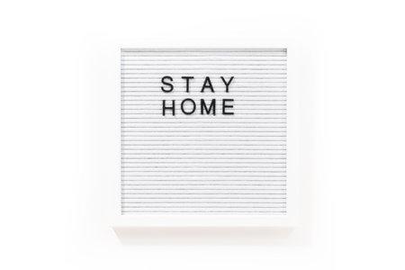 STAY HOME sign on message board. Archivio Fotografico