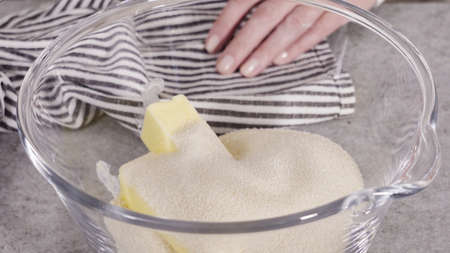 Mixing ingredients into the batter for lemon pound cake.