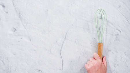Flat lay. Silicone cooking utensils with wooden handle.