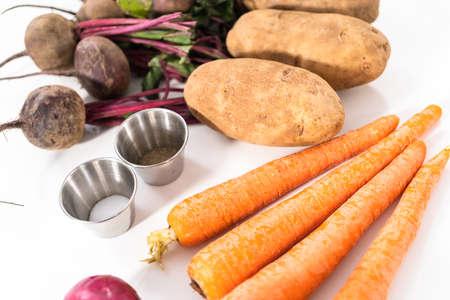Ingredients to prepare vinaigrette salad on the ocunter. Archivio Fotografico