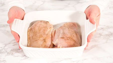 Step by step. Seasoning chicken with salt and pepper for baking in a baking dish.