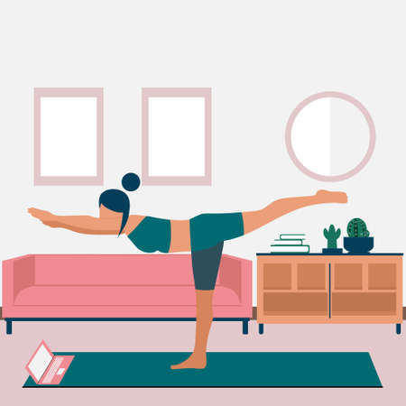 A young woman does yoga online in her apartment. The girl standing in the warrior pose Virabhadrasana. Home practice of yoga exercises during quarantine. Online courses, education on a laptop.