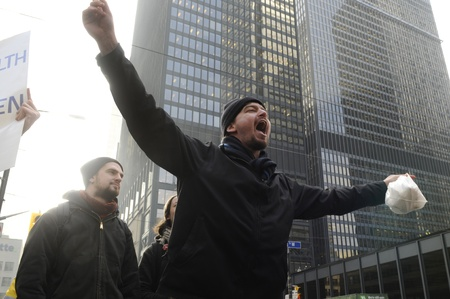TORONTO - NOVEMBER 24  An angry occupy Toronto protester chanting slogans in downtown Toronto during a occupy movement rally on November 24, 2011 in Toronto, Canada