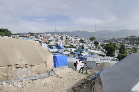 tent city: PORT-AU-PRINCE - AUGUST 28:Residents sharing their view in one of the Tent City on August 28, 2010 in Port-Au-Prince, Haiti Editorial