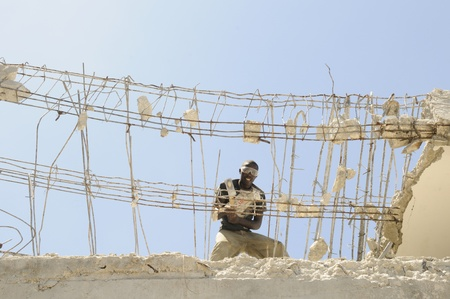 PORT-AU-PRINCE - AUGUST 30: A Haitian worker working on reconstruction, in Port-Au-Prince, Haiti on August 30, 2010.