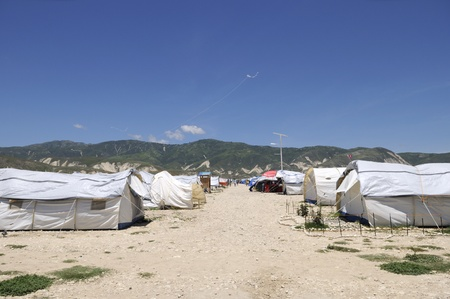 tent city: PORT-AU-PRINCE - AUGUST 30: Kites flying in one of the tent city in Port-Au-Prince, Haiti on August 30, 2010.