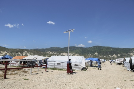 tent city: PORT-AU-PRINCE - AUGUST 30: A solar system in one of the tent city , in Port-Au-Prince, Haiti on August 30, 2010.