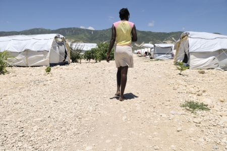 PORT-AU-PRINCE - AUGUST 30: An Haitian girl walking towards her tent in one of the tent city in Port-Au-Prince, Haiti on August 30, 2010.
