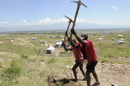 PORT-AU-PRINCE - AUGUST 30: Residents working on top of a hill to migrate their tent from another part of the city ,in Port-Au-Prince, Haiti on August 30, 2010.