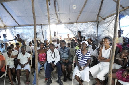 PORT-AU-PRINCE - AUGUST 31:Residents gathered in a meeting to decide on the future action regarding the alleged atrocities of the NGO