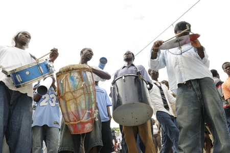 PORT-AU-PRINCE -SEPTEMBER 1: A local band playing music during a funeral of a 6 months old baby who was burnt alive inside his tent while asleep on September 1 2010 in Port-Au-Prince,Haiti.