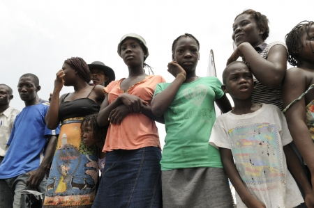 PORT-AU-PRINCE - SEPTEMBER 1: Camp residents standing on the street to witness a rally, in Port-Au-Prince, Haiti on September 1, 2010.