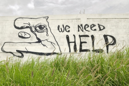 PORT-AU-PRINCE - SEPTEMBER 1: A wall writing pleading for help in in Port-Au-Prince, Haiti on September 1, 2010. Editorial