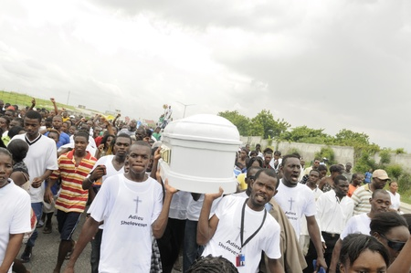 PORT-AU-PRINCE -SEPTEMBER 1:Pall-bearers carrying the casket of a 6 months old baby who was burnt alive inside his tent while fast asleep on September 1 2010 in Port-Au-Prince,Haiti.