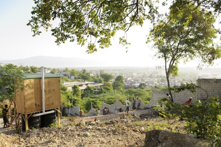 PORT-AU-PRINCE - SEPTEMBER 2: Residents creating space for another tent to be migrated , in Port-Au-Prince, Haiti on September 2, 2010.