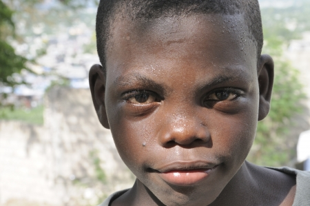 PORT-AU-PRINCE - SEPTEMBER 2: A happy looking innocent unidentified Haitian kid during a camp in Port-Au-Prince, Haiti on September 2, 2010.