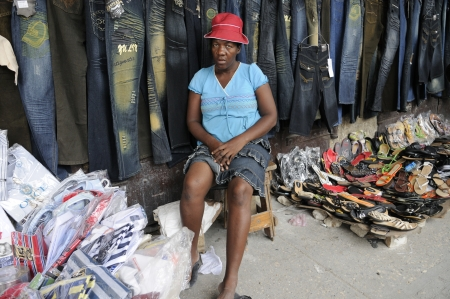 PORT-AU-PRINCE - AUGUST 21: A vendor selling clothes on the streets of Port-Au-Prince, Haiti on August 21, 2010.