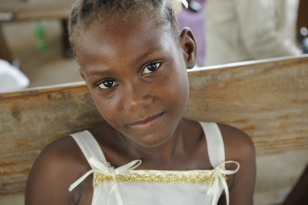 PORT-AU-PRINCE - AUGUST 22: An unidentified Haitian child sharing a smile during a food distribution camp,in Port-Au-Prince, Haiti on August 22, 2010. Editorial