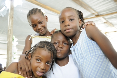 PORT-AU-PRINCE - AUGUST 22: A group of Haitian kids having fun amongst themselves during a food distribution camp,in Port-Au-Prince, Haiti on August 22, 2010.