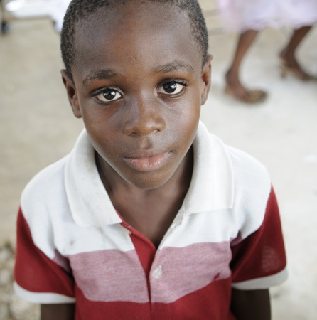 food distribution: PORT-AU-PRINCE - AUGUST 22: Innocent look of an unidentified Haitian child during a food distribution camp in Port-Au-Prince, Haiti on August 22, 2010. Editorial