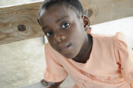 PORT-AU-PRINCE - AUGUST 22: An unidentified Haitian girl sitting on the bench of a destroyed church ,in Port-Au-Prince, Haiti on August 22, 2010.