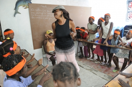 PORT-AU-PRINCE - AUGUST 25: A school teacher dancing in front of her students in one of the schools in Cite Soleil, in Port-Au-Prince, Haiti on August 25, 2010.