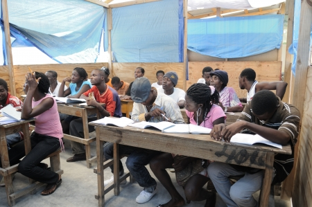 CITE SOLEIL- AUGUST 25: Students of all ages attending classes in a local community school in Cit�© Soleil- one of the poorest area in the Western Hemisphere on August 25 2010 in Cite Soleil, Haiti.