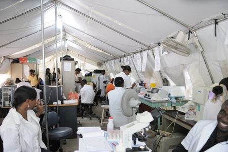 PORT-AU-PRINCE - AUGUST 26: Health workers of Haiti working in a temporary tent pathological lavatory on August 26 2010 in Port-Au-Prince, Haiti.