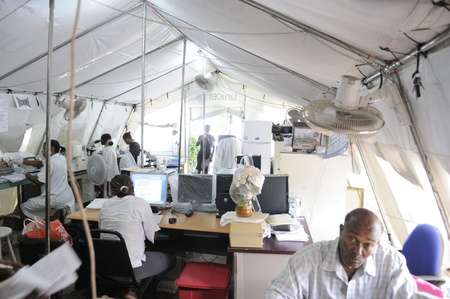 PORT-AU-PRINCE - AUGUST 26: Pathologists testing samples in a temporary tent lab on August 26 2010 in Port-Au-Prince, Haiti.